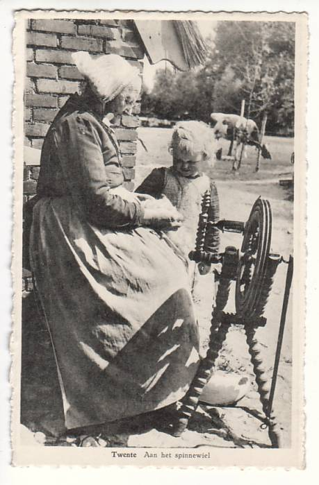 old_dutch_woman_teaching_child_to_spin